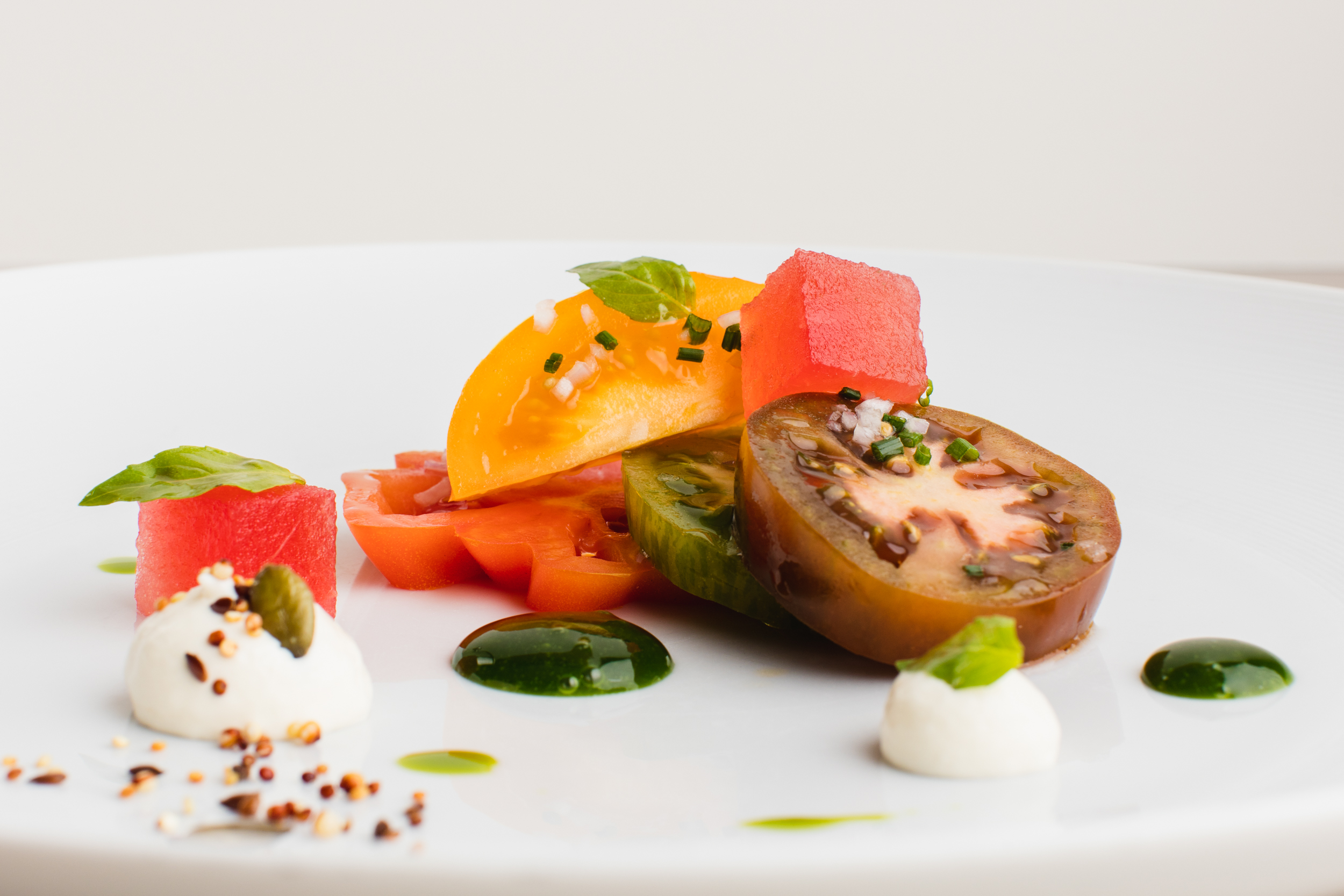 heritage-tomatoes-with-burrata-cream-pressed-water-melon-and-basil