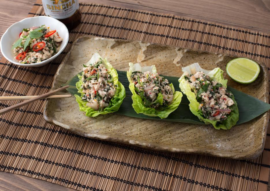 Kra Pow Chilled minced chicken salad served inside lettuce leaves